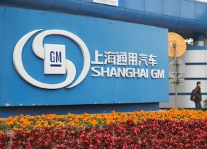 A man walks past thea Shanghai GM plant